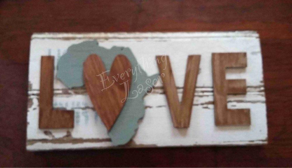 Africa Love on reclaimed skirting board